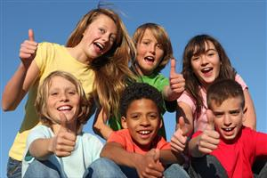 children posing with thumbs up